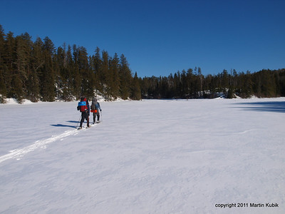 Snowshoeing toward the triangle.  Again, we marveled at how easy it was to walk on lakes compared to trudging through deep snow in forest.  No worry about thin ice here, either.