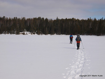 Crossing the Crow Lake.  We looked forward to snowshoeing on lakes where the snow was packed and travel was much easier than in deep snow of the forest.