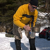 Rod refilling the water bottle.   It is not very often that one engage in snowcamping activities without wearing gloves!