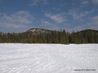 We finally reach a milestone, Shrike Lake.   Here is the forbidding Eagle Mountain, highest point of Minnesota, 2,301 feet tall (give or take a few).   This view is that of the Czech Direct Route, name after a famous Czech mountaineer who pioneered it.