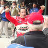 Hélio Castroneves celebrates winning the pole