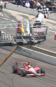 Justin Wilson takes the checkered flag on his qualification run.