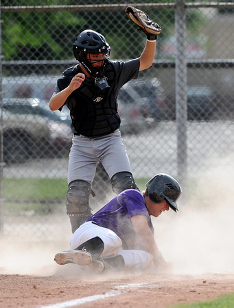 "Dylan Platt gets out by sliding into home at the bottom of the first inning during the Pomona at Boulder Legion A baseball game at Scott Carpenter Park.<br /> Photo by Rachel Woolf For The Boulder Camera<br /> For more photos go to  <a href=""http://www.dailycamera.com"">http://www.dailycamera.com</a><br /> June 6, 2012"