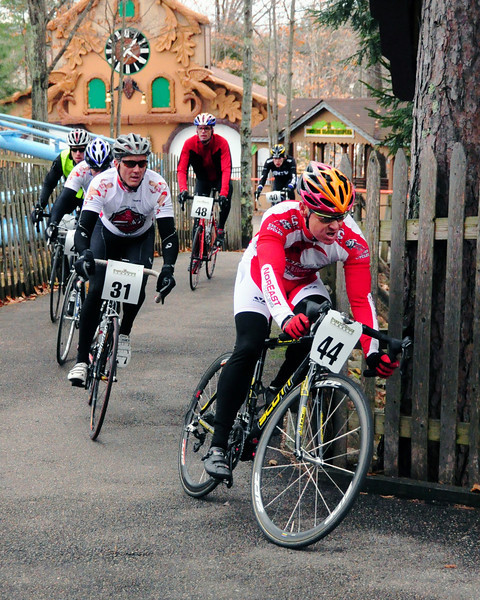 "The Porky Gulch Classic, a 3 stage bicycle race, presented by Great Glen Trails, of Gorham, NH, was held on November 6th & 7th, 2010. Joseph Reagan, of Hookset, leads Jeremy Andrew (#31), of Middletown, and a pack of riders, during the event's 2nd stage, ""The Story Land Criterium"", which was held at Story Land, a popular theme park in Glen, NH, on Saturday, November 6th, 2010."