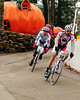 "The Porky Gulch Classic, a 3 stage bicycle race, presented by Great Glen Trails, of Gorham, NH, was held on November 6th & 7th, 2010. Pete Ostroski (#10), of Intervale, leads David Mai (#2), of Portland, Maine, and several others, past a unique attraction, during the event's 2nd stage, ""The Story Land Criterium"", which was held at Story Land, a popular theme park in Glen, NH, on Saturday, November 6th, 2010."