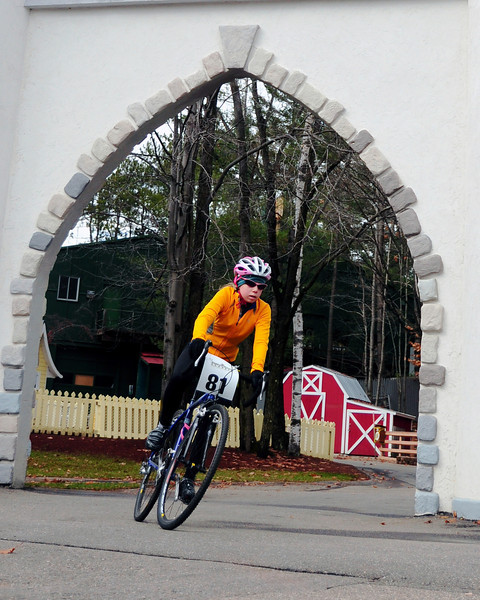 "The Porky Gulch Classic, a 3 stage bicycle race, presented by Great Glen Trails, of Gorham, NH, was held on November 6th & 7th, 2010. Lizzy Duffy, 14, of Jackson, NH, races through a castle, during the event's 2nd stage, ""The Story Land Criterium"", which was held at Story Land, a popular theme park in Glen, NH, on Saturday, November 6th, 2010."