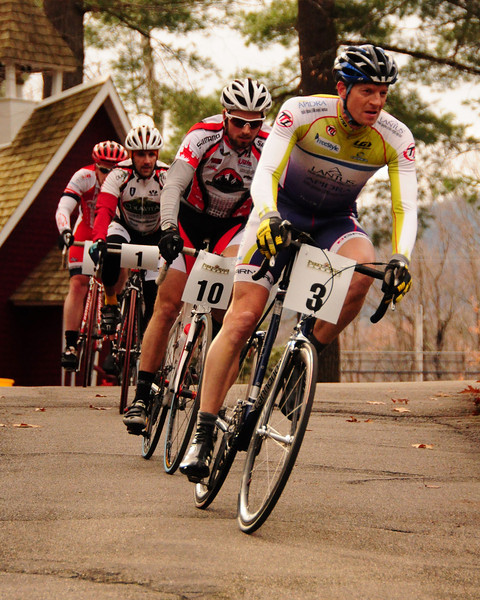 """The Porky Gulch Classic, a 3 stage bicycle race, presented by Great Glen Trails, of Gorham, NH, was held on November 6th & 7th, 2010. Steve Piotrow, of Jackson, NH, stays just ahead of Pete Ostroski (#3), of Intervale, and a pack of riders, during the event's 2nd stage, """"The Story Land Criterium"""", which was held at Story Land, a popular theme park in Glen, NH, on Saturday, November 6th, 2010."""