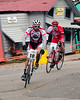 "The Porky Gulch Classic, a 3 stage bicycle race, presented by Great Glen Trails, of Gorham, NH, was held on November 6th & 7th, 2010. Pete Ostroski (#10), of Intervale, NH, and Scott Brooks, race through an old western town, during the event's 2nd stage, ""The Story Land Criterium"", which was held at Story Land, a popular theme park in Glen, NH, on Saturday, November 6th, 2010."