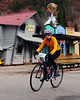 "The Porky Gulch Classic, a 3 stage bicycle race, presented by Great Glen Trails, of Gorham, NH, was held on November 6th & 7th, 2010. Lizzy Duffy, 14, of Jackson, NH, rides through an old western town, during the event's 2nd stage, ""The Story Land Criterium"", which was held at Story Land, a popular theme park in Glen, NH, on Saturday, November 6th, 2010."