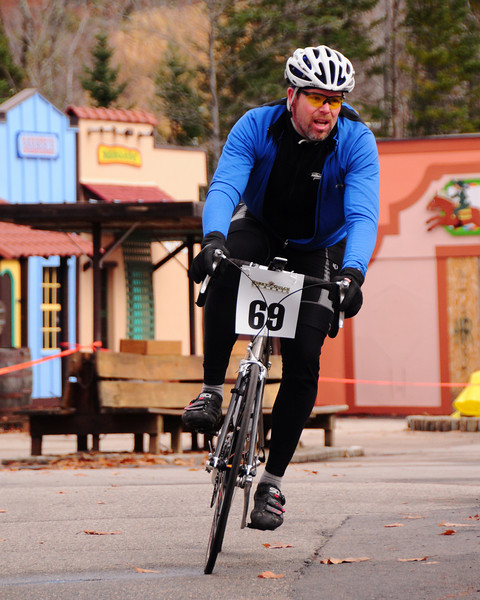 "The Porky Gulch Classic, a 3 stage bicycle race, presented by Great Glen Trails, of Gorham, NH, was held on November 6th & 7th, 2010. Mike Duffy, of Jackson, NH, rides through an old western town, during the event's 2nd stage, ""The Story Land Criterium"", which was held at Story Land, a popular theme park in Glen, NH, on Saturday, November 6th, 2010."