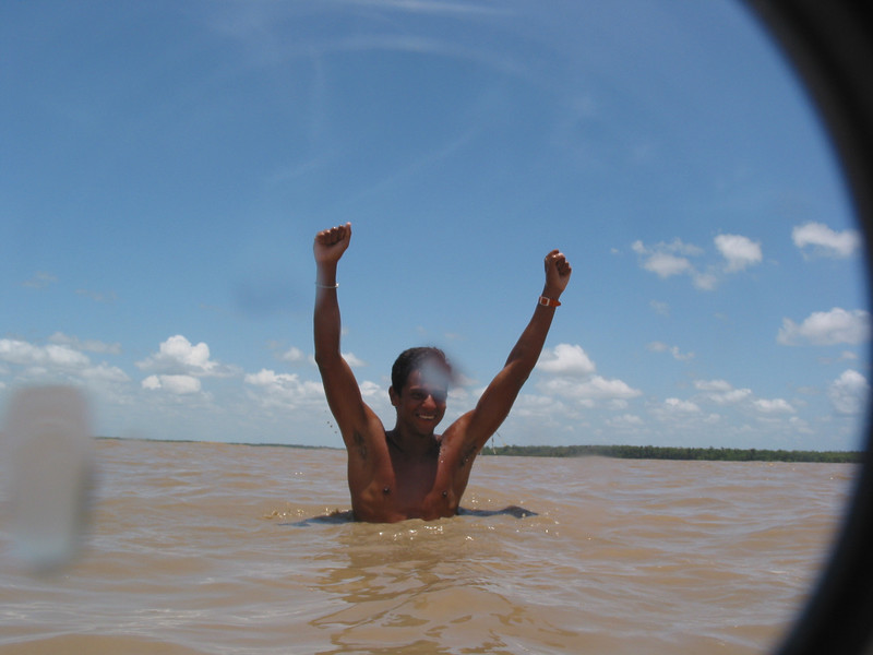 "Surfer Adilton Mariano raises his hands in celebration after winning the ""I Pororoca Surf Challenge"" on the tidal bore wave, known as pororoca, in the Araguari River of Brazil's Amazonian state of Amapa. Six reknown Brazilian surfers battled the wave in two elimination heats and one final to see who could surf the wave the longest. Mariano had record time of 34:10. The Araguari pororoca is possibly the most feared of all the Amazonian tidal bores, and local residents of the remote areas surrounding the mouth of the river always feared the thunderous waves which capsizes boats and washes away anything in its path twice daily. Thanks to a group of daring surfers, they have begun to see the wave in a different way: as a tourist attraction to generate money in one of the poorest regions of Brazil.(AustralFoto/Douglas Engle)"