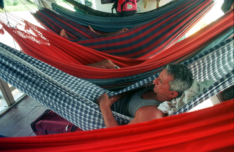 Surfer Chico Pinheiro relaxes in a hammock during a boat ride while returning from fresh-water surf adventure on the Araguari River in Brazil's amazonian state of Amapa. Surfers take a 12 hour boat ride, and a 3 hour car ride to the mouth of the river in a quest to surf the tidal bore wave known as pororoca. The Araguari pororoca is possibly the most feared of all the Amazonian tidal bores, and local residents of the remote areas surrounding the mouth of the river always feared the thunderous waves which capsizes boats and washes away anything in its path twice daily. Thanks to a group of daring surfers, they have begun to see the wave in a different way: as a tourist attraction to generate money in one of the poorest regions of Brazil.(AustralFoto/Douglas Engle)