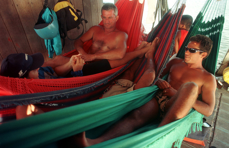 Surfers Mitchell Elleres, right, and Chico Pinheiro relax in hammocks during a boat ride on the Araguari River in Brazil's amazonian state of Amapa. The 12 hour journey is all part of an adventure to surf the  tidal bore wave, known as pororoca in the river. The Araguari pororoca is possibly the most feared of all the Amazonian tidal bores, and local residents of the remote areas surrounding the mouth of the river always feared the thunderous waves which capsizes boats and washes away anything in its path twice daily. Thanks to a group of daring surfers, they have begun to see the wave in a different way: as a tourist attraction to generate money in one of the poorest regions of Brazil. (AustralFoto/Douglas Engle)