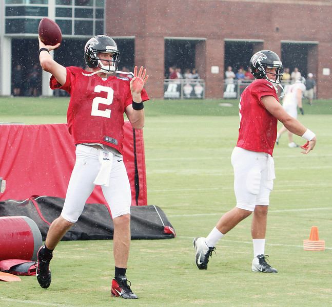 Atlanta Falcons quarterbacks Matt Ryan (2) and John Parker Wilson warm up during practice in Flowery Branch, Ga.