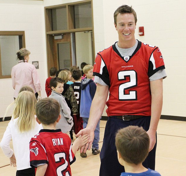 Atlanta Falcons quarterback Matt Ryan greets young fans at Haw Creek Elementary School.