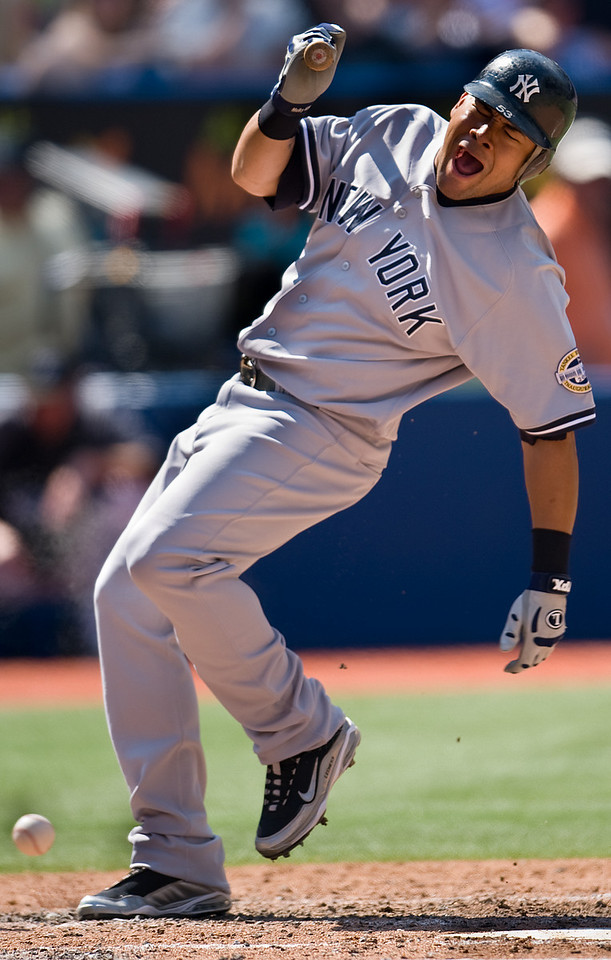 05 September 2009: New York Yankees center fielder Melky Cabrera #53 gets hit with a ball at the Rogers Centre during a Major League Baseball game between the New York Yankees and the Toronto Blue Jays. <br /> The Yankees won 6-4.