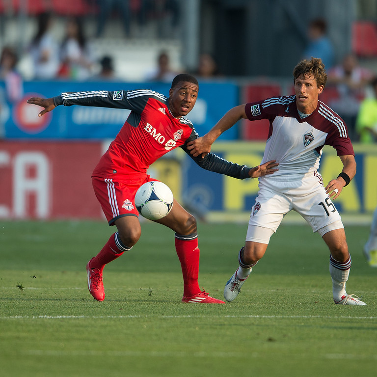18 July 2012: Colorado Rapids midfielder Wells Thompson #15 and Toronto FC midfielder Reggie Lambe #19 in action during an MLS game between the Colorado Rapids and Toronto FC at BMO Field in Toronto, Ontario.<br /> Toronto FC won 2-1.