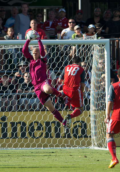 18 August 2012: Sporting KC goalkeeper Jimmy Nielsen #1and Toronto FC defender Darren O'Dea #48 in action during an MLS game between Sporting Kansas City and Toronto FC at BMO Field in Toronto, Ontario Canada.<br /> Sporting Kansas City won 1-0.