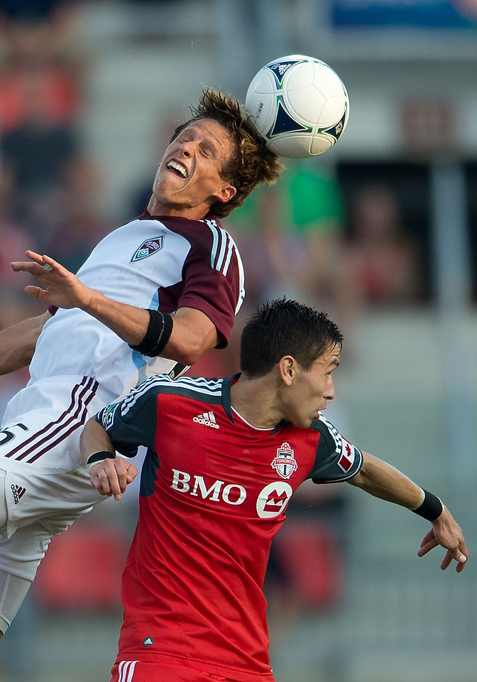 18 July 2012: Colorado Rapids midfielder Wells Thompson #15 and Toronto FC midfielder Eric Avila #8 in action during an MLS game between the Colorado Rapids and Toronto FC at BMO Field in Toronto, Ontario.<br /> Toronto FC won 2-1.