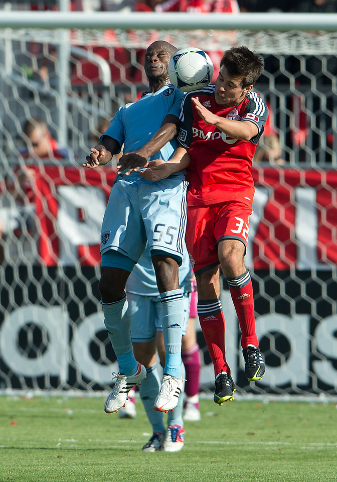 August 18, 2012: Sporting KC midfielder Julio Cesar #55 and Toronto FC forward Andrew Wiedeman #32 in action during an MLS game between Toronto FC and Sporting Kansas City at BMO Field in Toronto, Ontario Canada.<br /> Sporting Kansas City won 1-0.