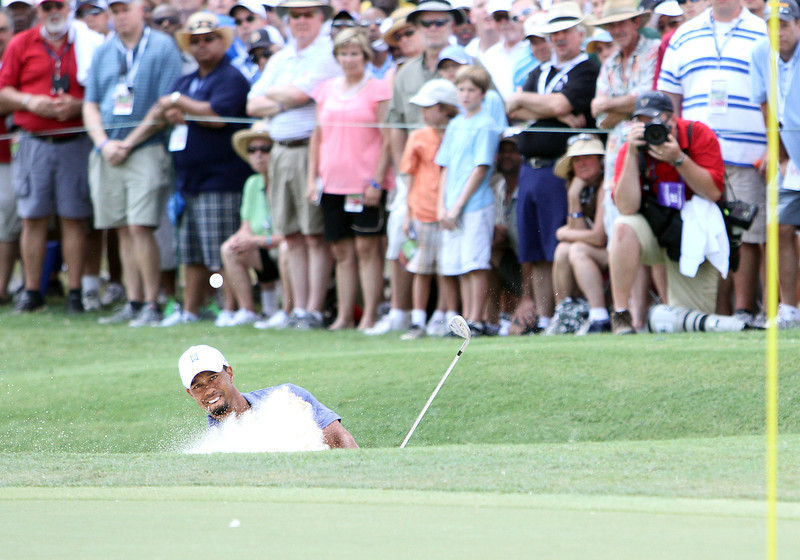 Tiger Woods hits out of the bunker at the 2011 PGA Championship.