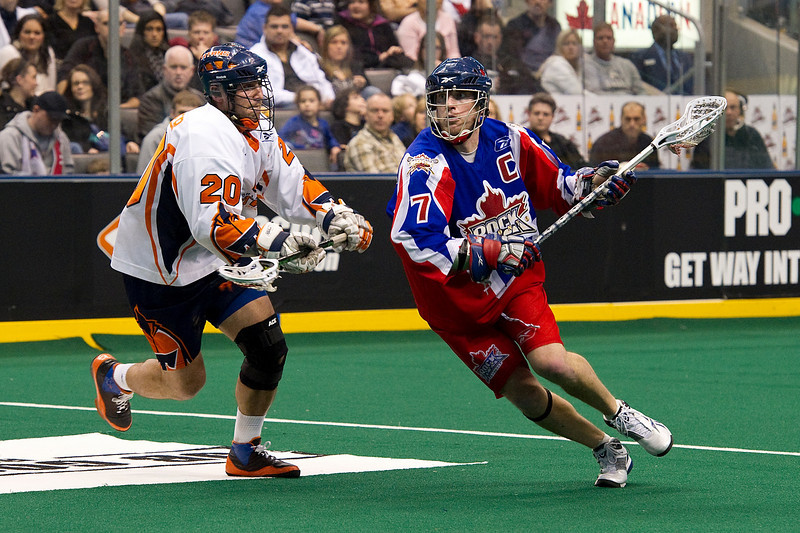 27 February 2010: Orlando Titans transition Greg Peyser #20 and Toronto Rock forward Colin Doyle #7 battle in the second half of play of the NLL Lacrosse game between the Orlando Titans and the Toronto Rock played at the Air Canada Centre in Toronto, Ontario.<br /> The Titans won 16-12.<br /> Mandatory Credit: Nick Turchiaro/Southcreek Global