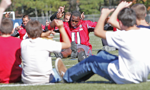 Atlanta Falcons wide receiver Julio Jones takes part in games with special needs children at South Forsyth High School.