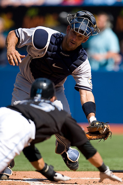 05 September 2009: New York Yankees catcher Jorge Posada #20 prepares to put the tag on Toronto Blue Jays left fielder Jose Bautista #23 at the Rogers Centre during a Major League Baseball game between the New York Yankees and the Toronto Blue Jays. <br /> The Yankees won 6-4.
