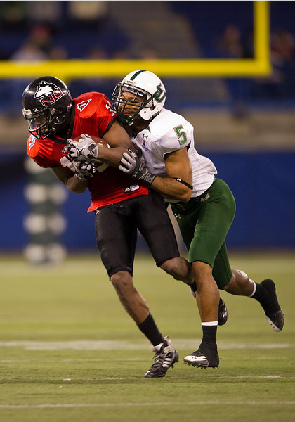 January 2 2010:  Northern Illinois wide receiver Marcus Lewis #11 makes a reception as South Florida safety Nate Allen #5 makes the tackle during the first half of the NCAA Football International Bowl at the Rogers Centre in Toronto, Ontario.
