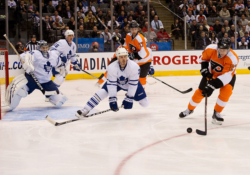 January 14 2010: Philadelphia Flyers center Mika Pyorala #27 takes a shot on the Leafs net as Toronto Maple Leafs defenseman Ian White #7 tries to block the shot during the first period in a game between the Philadelphia Flyers and the Toronto Maple Leafs at the Air Canada Centre in Toronto, Ontario.