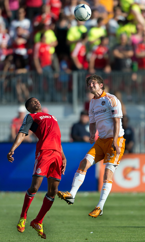 28 July 2012: Houston Dynamo defender Bobby Boswell #32 and Toronto FC foward/midfielder Ryan Johnson #9 in action during an MLS game between Toronto FC and the Houston Dynamo at BMO Field in Toronto,Ontario Canada.<br /> The Houston Dynamo won 2-0.