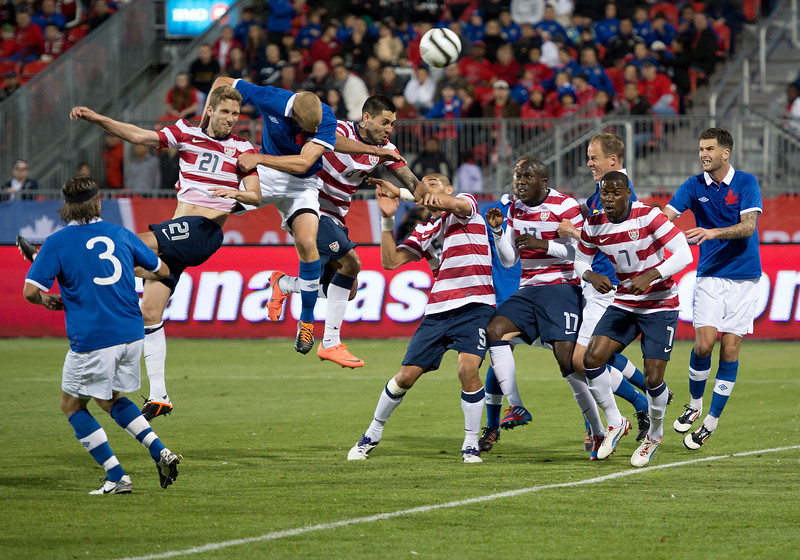 03 June 2012: US Men's National Soccer Team midfielder Clint Dempsey #8 battles for a header during an international friendly  match between the United States Men's National Soccer Team and the Canadian Men's National Soccer Team at BMO Field in Toronto.<br /> The game ended in 0-0 draw.