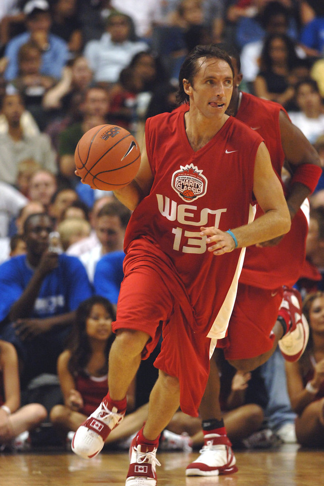 July 2005: Steve Nash takes the ball up court during the 2005 Steve Nash Charity Basketball Classic at the Air Canada Centre in Toronto, Ontario.