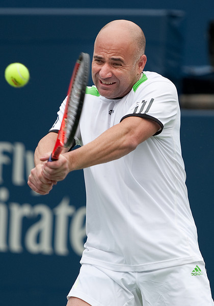 August 14 2011: Andre Agassi of USA in action during the Rogers Legends during the 2011 Rogers Cup Final at the Rexall Centre in Toronto, Ontario Canada.<br /> Andre Agassi won 2-6,6-2,10-4.
