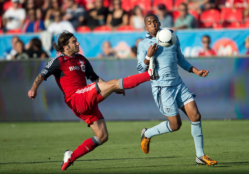 18 August 2012: Toronto FC midfielder Torsten Frings #22 and Sporting KC forward Teal Bunbury #9 in action during an MLS game between Sporting Kansas City and Toronto FC at BMO Field in Toronto, Ontario Canada.<br /> Sporting Kansas City won 1-0.