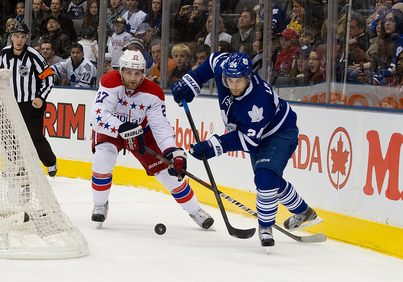 February 25 2012: Washington Capitals defenseman Karl Alzner #27 and Toronto Maple Leafs defenseman John-Michael Liles #24 in action during the third period in a game between the Washington Capitals and the Toronto Maple Leafs at the Air Canada Centre in Toronto, Ontario.<br /> The Washington Capitals won 4-2.
