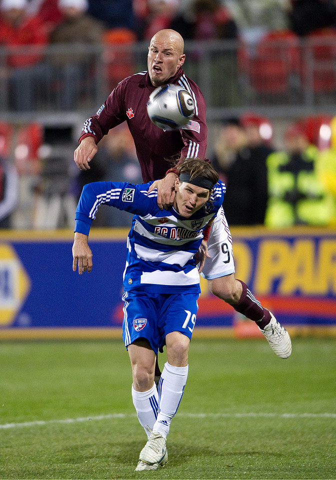 21 November 2010: Colorado Rapids forward Conor Casey #9 and FC Dallas defender Zach Loyd #19 in action during the 2010 MLS CUP between the Colorado Rapids and FC Dallas at BMO Field in Toronto, Ontario Canada.<br /> The Colorado Rapids won 2-1 in extra time.