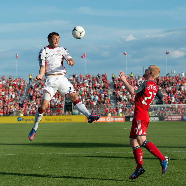 23 June 2011: New England Revolution forward Blake Brettschneider #23 and Toronto FC defender Richard Eckersley #27 in action during an MLS game between the New England Revolution and the Toronto FC at BMO Field in Toronto.<br /> The game ended in a 2-2 draw.