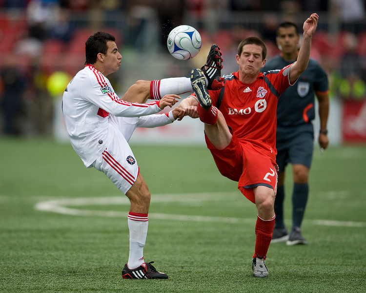 16 May 09: Chicago Fire midfielder Marco Pappa #16 and Toronto FC midfielder Sam Cronin #2 both go for the ball at BMO Field during a game between the Chicago Fire and Toronto FC.<br /> Chicago Fire won 2-0.<br /> Photo by Nick Turchiaro/isiphotos.com.