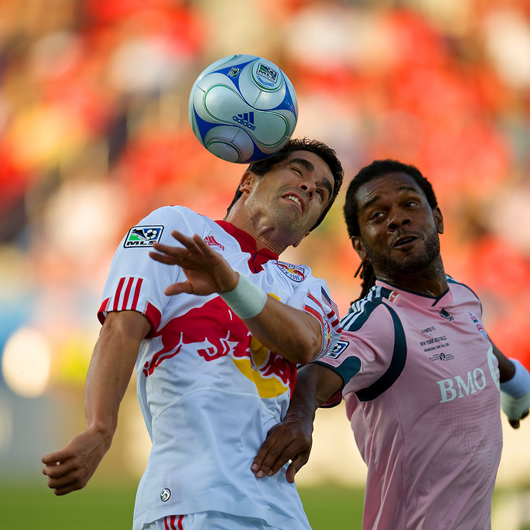 24 June2009: New York Red Bulls forward Juan Pablo Angel # 9 and Toronto FC defender Adrian Serioux #15 in action at BMO Field in Toronto, in a game between the New York Red Bulls and Toronto FC. Toronto FC won 2-0.<br /> Photo by Nick Turchiaro/isiphotos.com