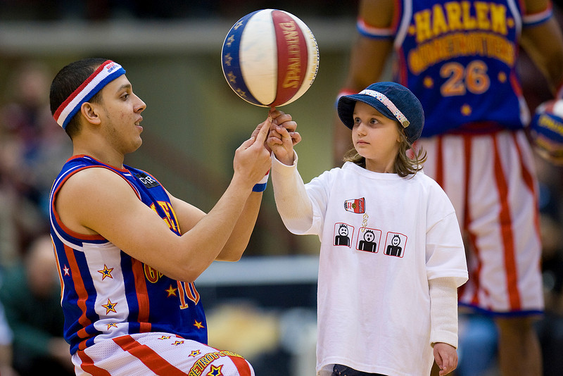 07 April 2009: Harlem Globetrotters Ken Rodriguex <br /> #10 shows a girl from the crowd on the fine art of spinning a basketball on one finger during their Spinning the Globe Tour at the General Motors Centre in Oshawa,Ontario. <br /> <br /> *****FOR EDITORIAL USE ONLY*****