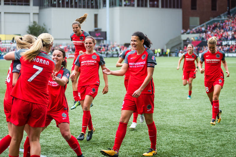 Christine Sinclair waits to shake Emily Sonnett's hand after she scores the game-winning goal against Orlando.