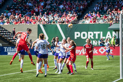 Christine Sinclair heads in a goal against the Orlando Pride in Portland, OR on May 12, 2018.