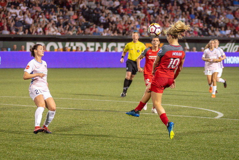 Lindsey Horan controls a ball against the Houston Dash in Portland, OR on July 16, 2018.