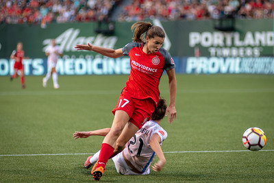 Tobin Heath escapes her Houston Dash defender in Portland, OR on July 16, 2018.