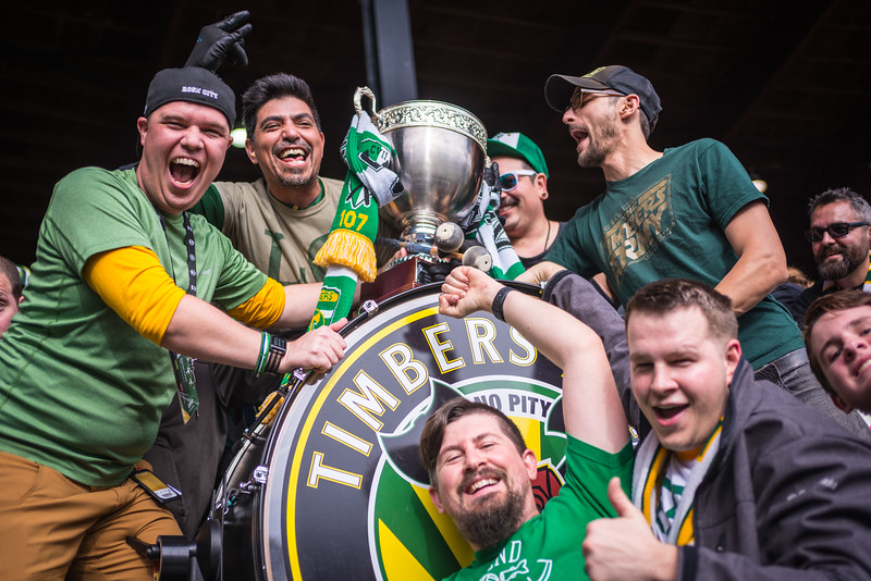 Members of the Timbers Army Drums & Trumpets with the Cascadia Cup.