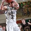Record-Eagle/Douglas Tesner<br /> <br /> MHSAA Class D Regional #30 Boys Basketball Ellsworth vs Leland