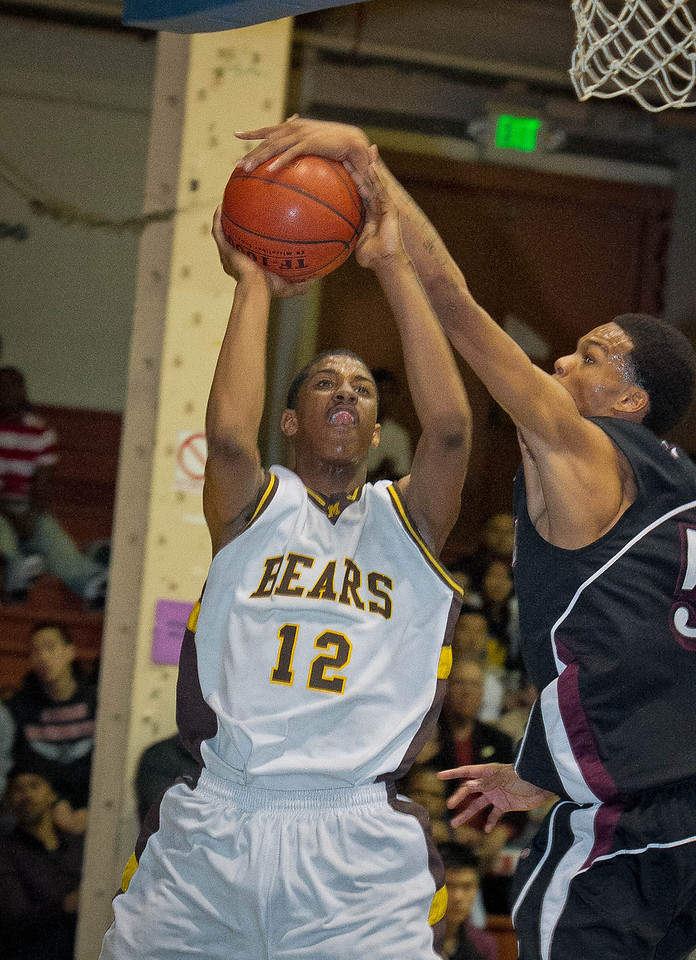 Gione Edwards of Mission High drives to the basket as Mark Alexander, (55), of Marshall High defends as Mission beats Marshall in the San Francisco Section Basketball Championship at Kezar Pavilion in San Francisco, Calif., on Friday, March 2, 2012.
