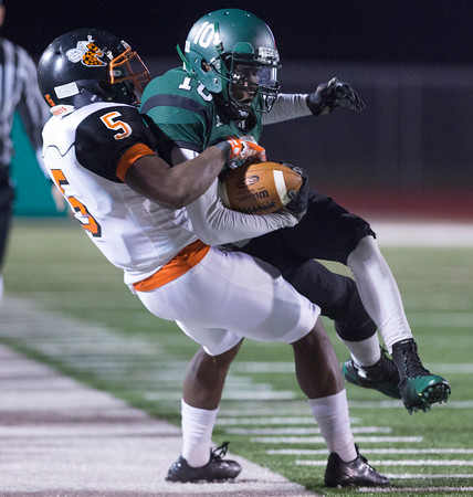 Phoenix special photo by Von Castor<br /> Muskogee's J'mari Davis is tackled by Booker T.<br /> Washington's Rylan McQuarters on Friday.