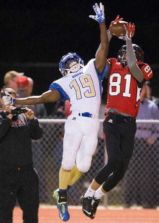 Phoenix special photo by Von Castor<br /> Hilldale's Grant Sikes, right, outjumps Tulsa Rogers' Liggins Lazarius as the Hornets completed a 10-0 regular season with a 51-12 win on Friday. Hilldale will host Sperry next Friday in a first-round playoff game.